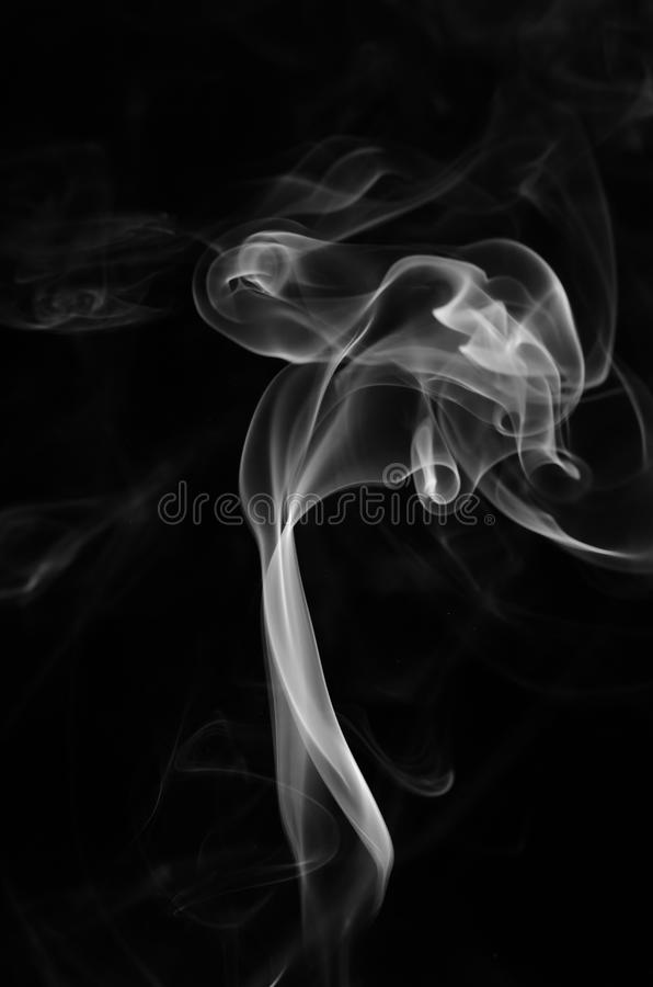 Abstract smoke. Isolated on dark background, with copy space royalty free stock photography