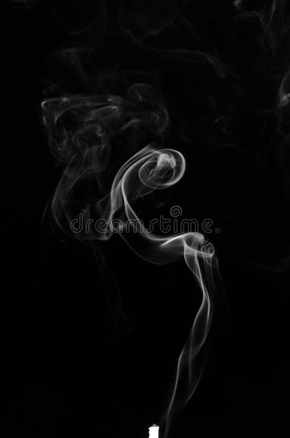 Abstract smoke. Isolated on dark background, with copy space stock photos