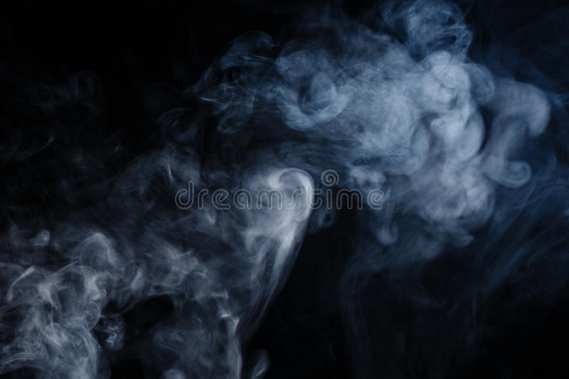 Abstract smoke moves. On a black background stock photos