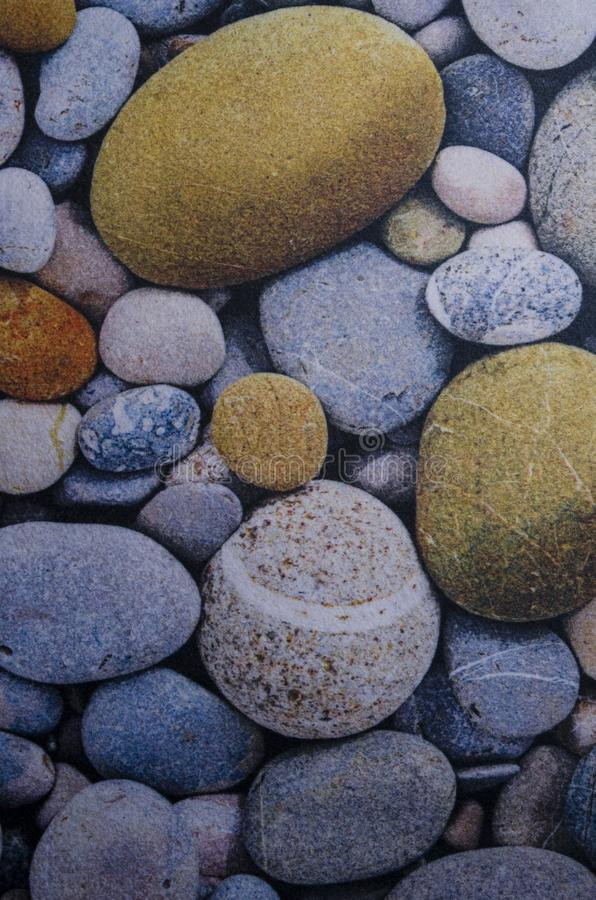 Abstract smooth round pebbles sea texture background stock images