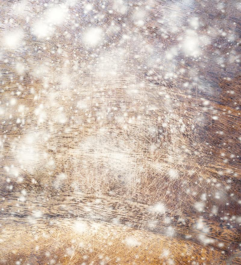Abstract Snow Background with wooden texture and falling snowflakes. Christmas Card with copy space. stock images