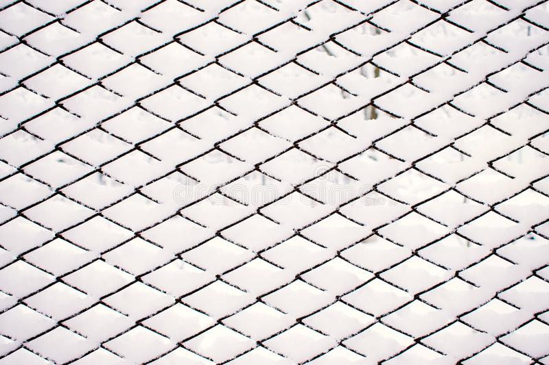 Abstract Snow winter pattern, Metal grid with white sticking snow royalty free stock photos