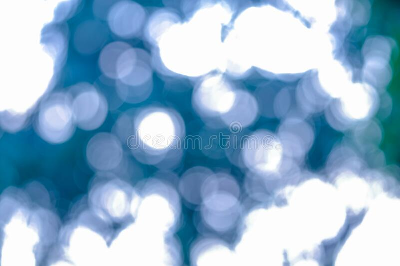 Abstract soft light bokeh circle blue and green light background. beauty defocus shine twinkle effect. no people. White growing light bubble in sky stock photos