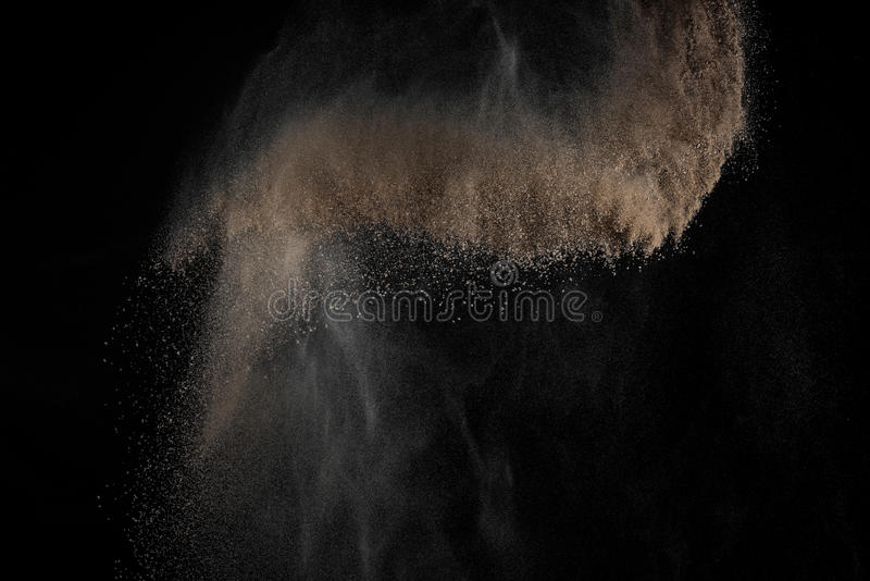Abstract soil explosion. Soil explosion isolated on black background. Abstract cloud of brown ground royalty free stock photo
