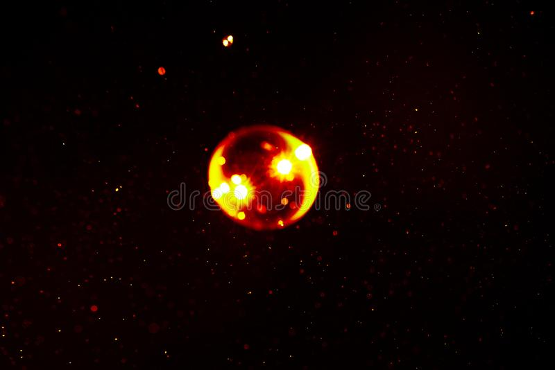 Abstract space background of soap yellow and red color bubbles with flare royalty free stock images