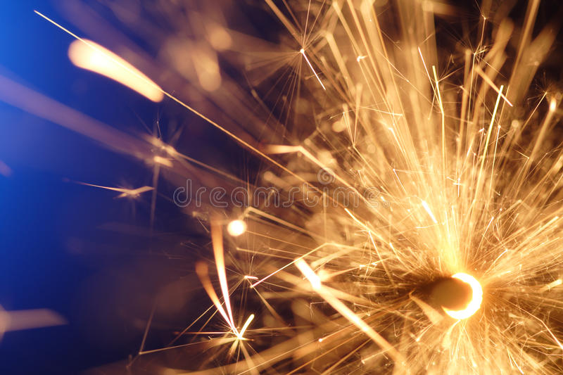Abstract sparkler. On blue background stock photo