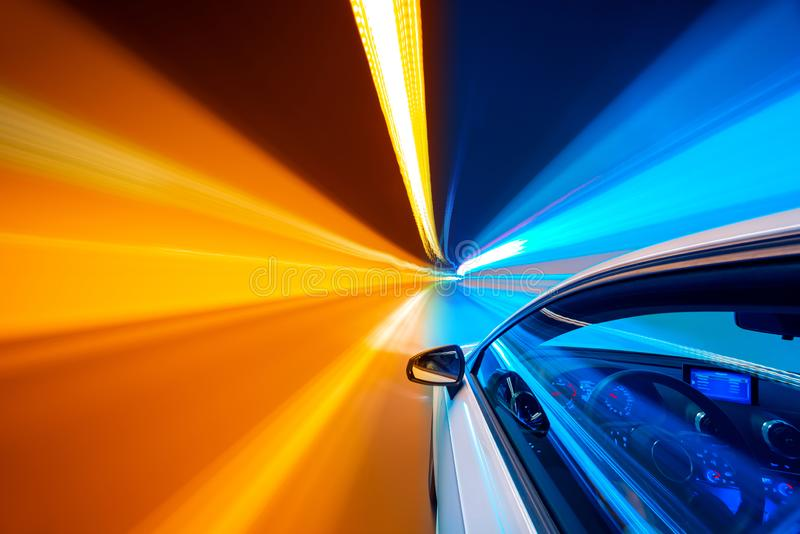 Abstract speed motion in tunnel, blurred motion. Abstract colors speed motion in urban highway road tunnel, blurred motion toward the central. Shot from side a stock image