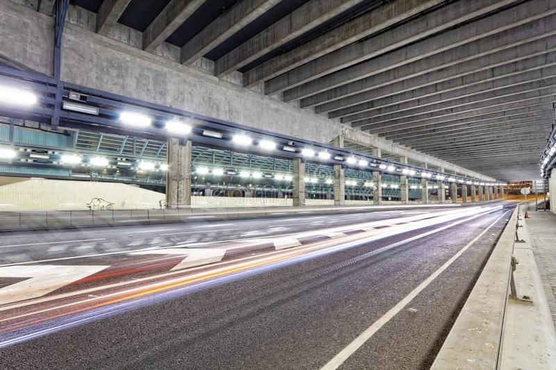 Abstract speed motion in urban highway road tunnel, blurred motion toward the central. stock images