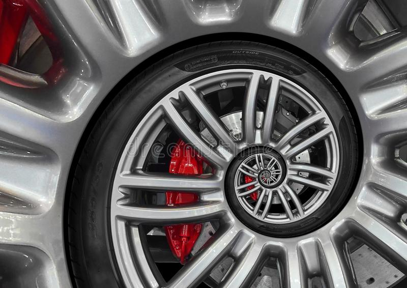 Abstract sport car spiral wheel rim with tire, brake disc. Automobile repetitive pattern background illustration. Car wheel and ti. Re twisted into spiral royalty free stock images