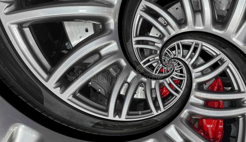 Abstract sport car spiral wheel rim with tire, brake disc. Automobile repetitive pattern background illustration. Car wheel and ti royalty free stock photos