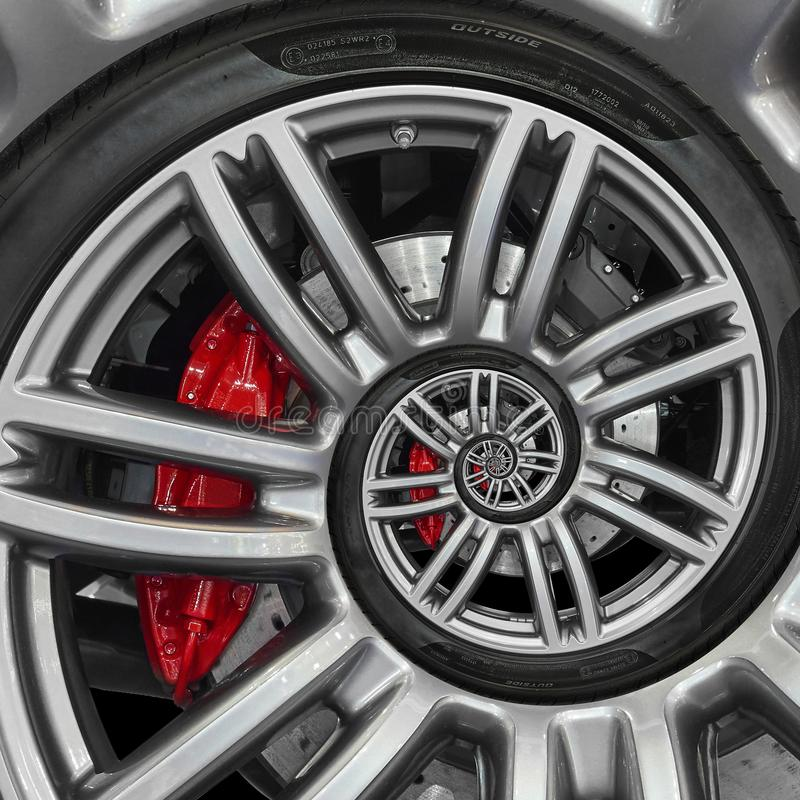 Abstract sport car spiral wheel rim with tire, brake disc. Automobile repetitive pattern background illustration. Car wheel and ti royalty free stock images