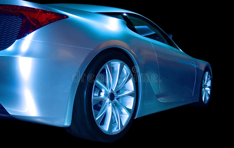Abstract Sports Car. Blue sports car with an abstract tint applied. Isolated on a black background stock photos