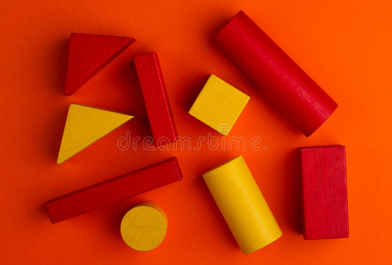Abstract square color composition with wood blocks. Abstract color composition with colorful wood toy building blocks on red background royalty free stock photos