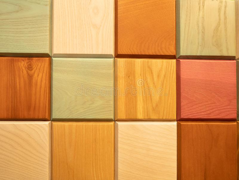Abstract square pattern made from colorful wooden blocks stock images