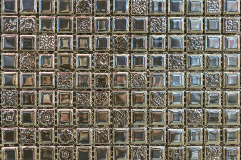 abstract square pixel mosaic wall background and texture. brown glass mosaic tile background pattern stock photo