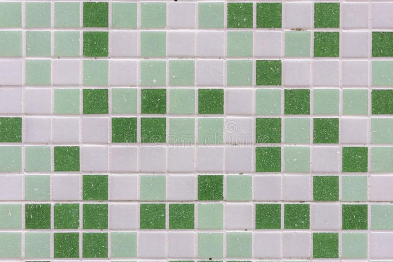 abstract square pixel mosaic wall background and texture. Green glass mosaic tile background pattern royalty free stock photos