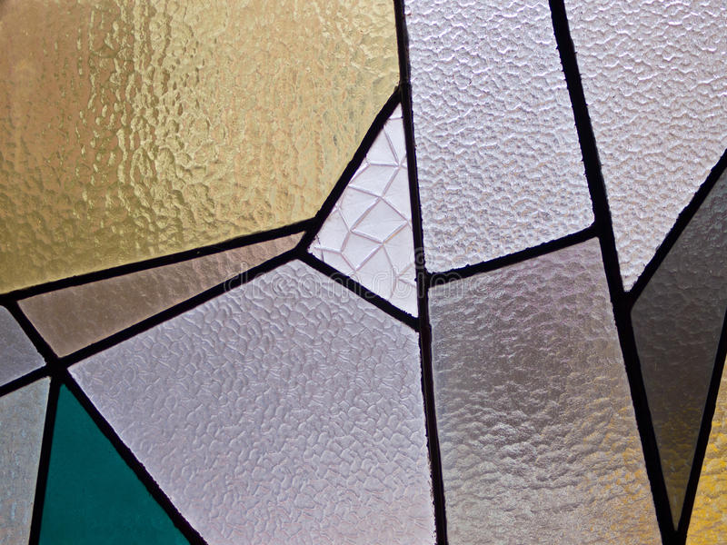 Abstract stained glass. Modern art stained glass in a new church stock image