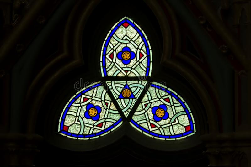 Abstract stained glass window in the chapel of Chaalis abbey stock photos