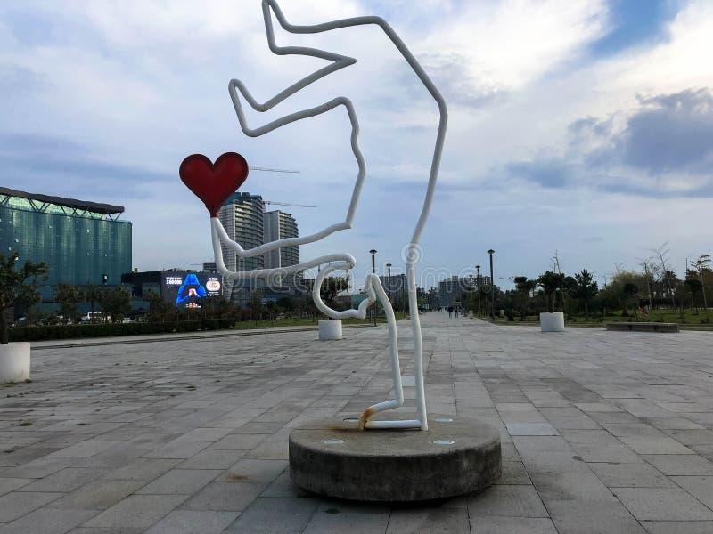 Abstract statues with a man holding a heart on Batumi Primorsky Boulevard or Batumi Beach. Georgia, Batumi, April 17, 2019 royalty free stock photos
