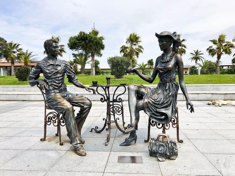 Abstract statues architectural of people drinking tea on Batumi seaside boulevard or Batumi Beach. Georgia, Batumi, April 17, 2019 royalty free stock images