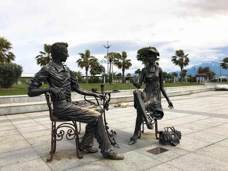 Abstract statues architectural of people drinking tea on Batumi seaside boulevard or Batumi Beach. Georgia, Batumi, April 17, 2019 royalty free stock image