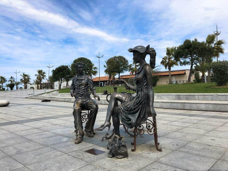 Abstract statues architectural of people drinking tea on Batumi seaside boulevard or Batumi Beach. Georgia, Batumi, April 17, 2019 royalty free stock photo