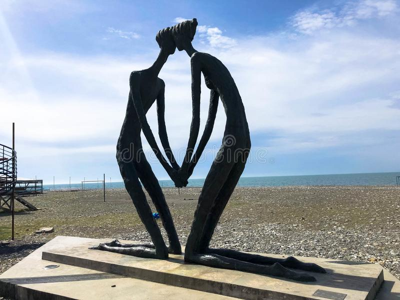 Abstract statues of people in love on the Batumi Primorsky Boulevard or Batumi Beach. Georgia, Batumi, April 17, 2019 royalty free stock images