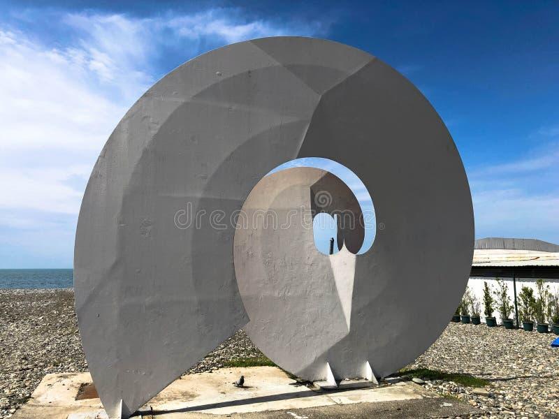 Abstract statues of spiral, forms of bekonechnosti on Batumi Primorsky Boulevard or Batumi Beach. Georgia, Batumi, April 17, 2019 stock photography
