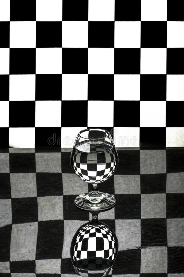 Abstract still life with a glass stock photography