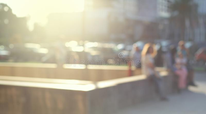 Abstract street city light blur background. Soft focus. Group of people. Abstract street city light blur blinking background. Soft focus. Group of people stock image