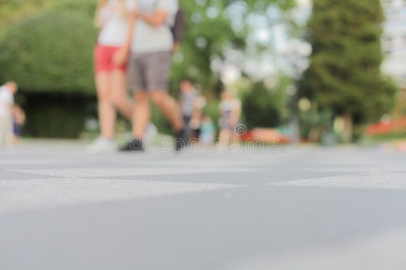 Abstract street city light blur blinking background. Soft group of people view from below. Abstract street city light blur blinking background. Soft focus. Group stock image