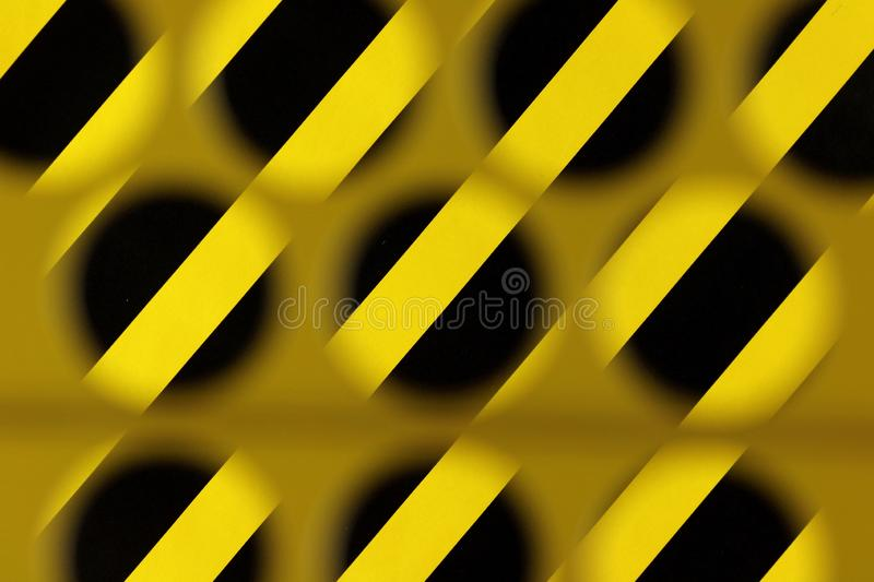 Abstract stripe and circle pattern in yellow and black. Danger, warning stock photos