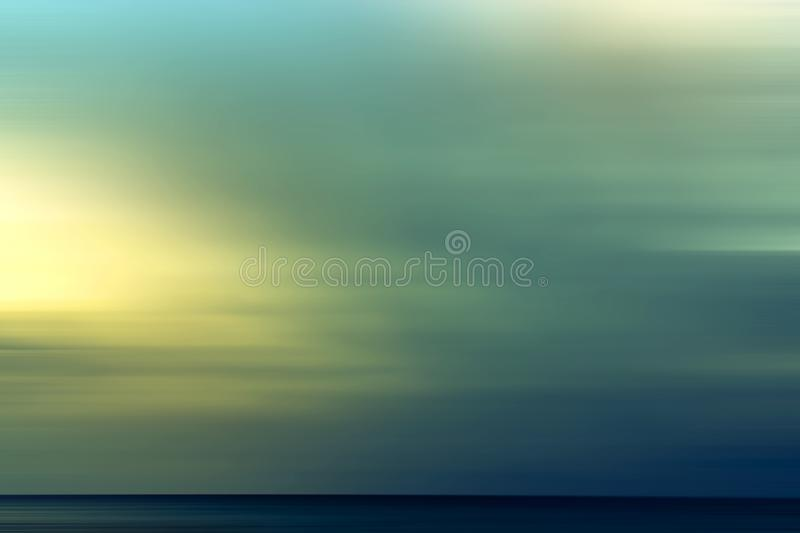 Abstract summer background with the setting sun over the sea. Colorful sunshine texture pastel landscape natural sky blurred beautiful nature wallpaper happy stock photography