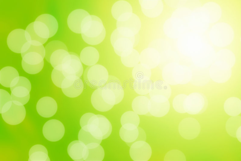 Abstract Sun Flares. Sun flares on a green natural abstract background royalty free stock photo