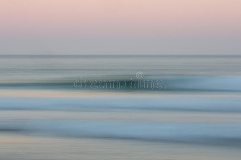 Abstract sunrise ocean background with blurred panning motion. Abstract sunrise ocean with sky background with blurred panning motion causing soft feel stock images