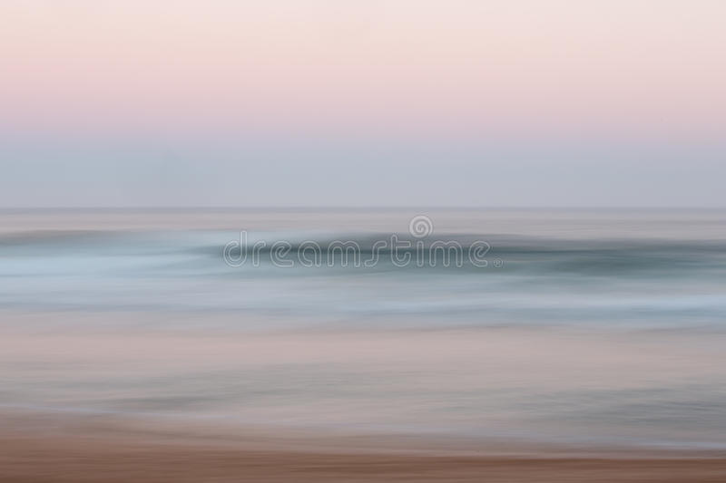 Abstract sunrise ocean background with blurred panning motion. Abstract sunrise ocean with sky background with blurred panning motion causing soft feel royalty free stock photo