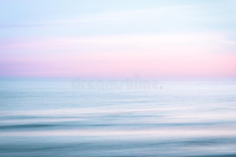 Abstract sunrise sky and ocean nature background. Abstract sunset sky and ocean nature background with blurred panning motion royalty free stock image