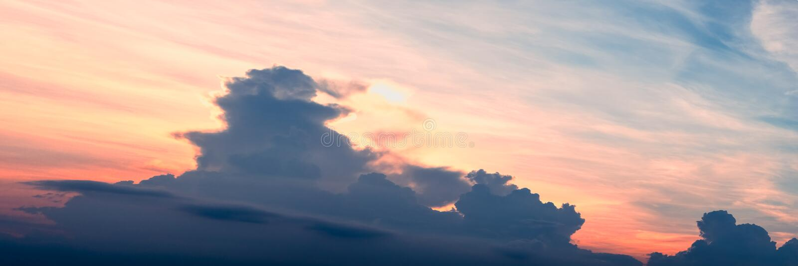 Abstract sunset with beautiful color sky and clouds nature panorama background. Moody pink, orange, purple clouds sun set sky stock photos