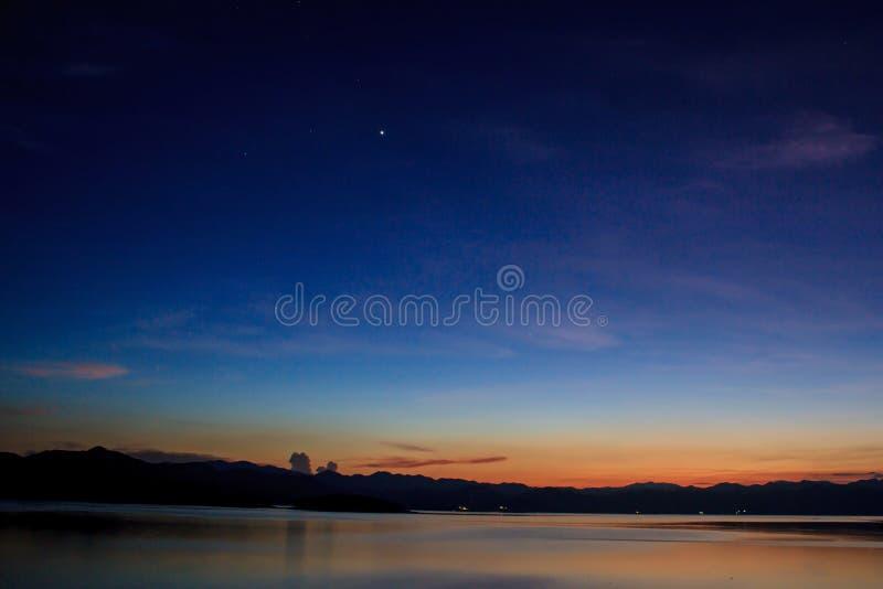 Abstract Sunset at lake. Sunset at lake, Kaengkrachan National Park Thailand,Sunset over lake with the beautiful cloud royalty free stock photography