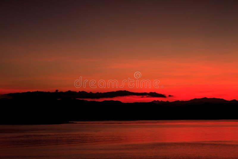 Abstract Sunset at lake. Sunset at lake, Kaengkrachan National Park Thailand,Sunset over lake with the beautiful cloud royalty free stock images