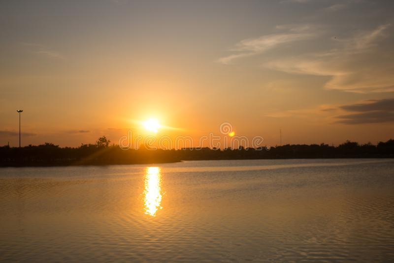 Abstract sunset over water surface in Thailand royalty free stock images