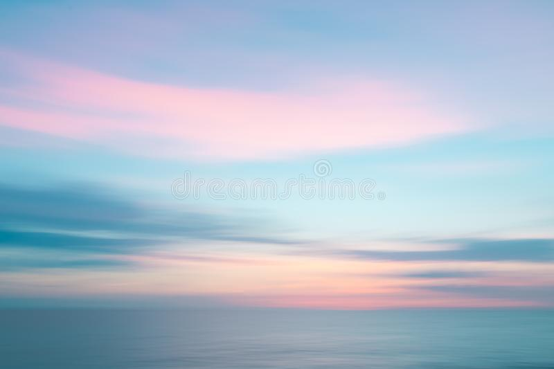 Abstract sunset sky and ocean nature background. Abstract colorful sunset sky and ocean nature background with blurred panning motion stock photos