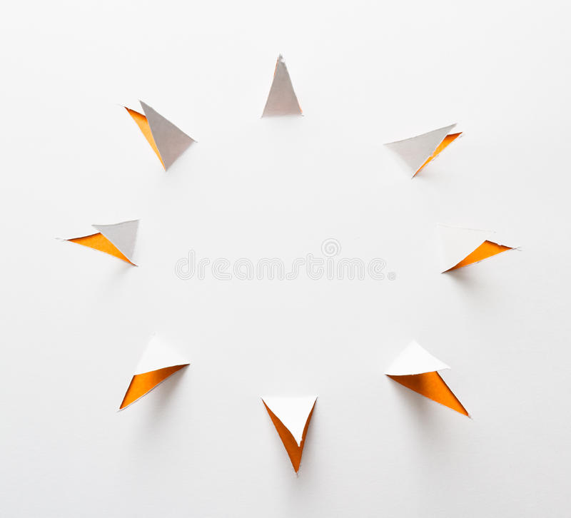 Abstract sunshine. Abstract paper cut with triangles around a main circle to form the sun shape on white royalty free stock photos