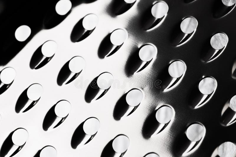 Abstract surface of metal grater as a background - Image stock photography