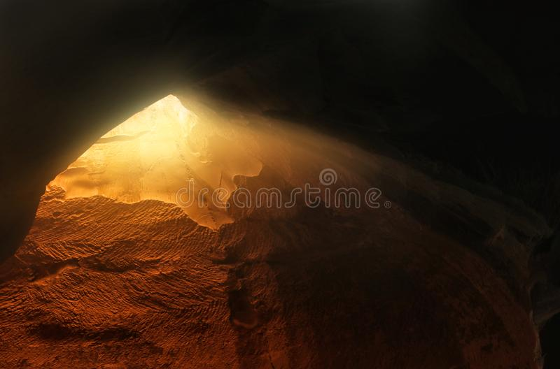 Abstract and surrealistic image of cave with light. revelation and open the door, Holy Bible story concept.  royalty free stock photography