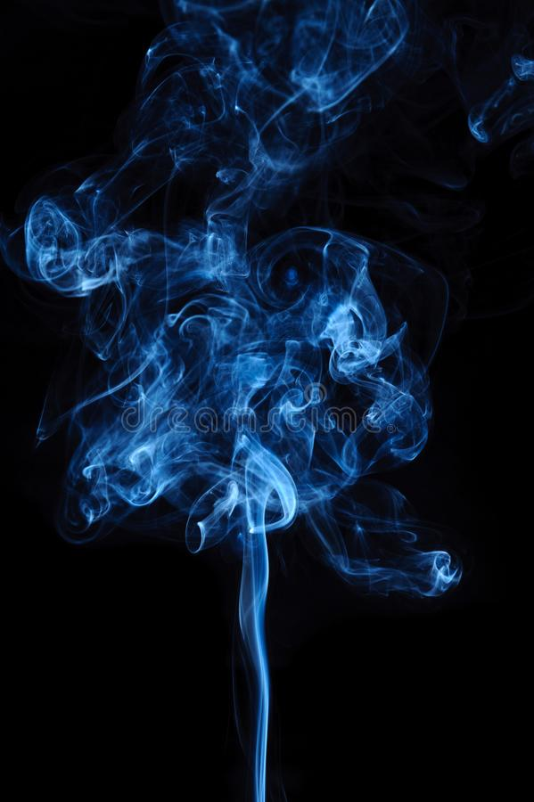 Abstract swirl blue smoke movement on black. Fantasy smoke stock images