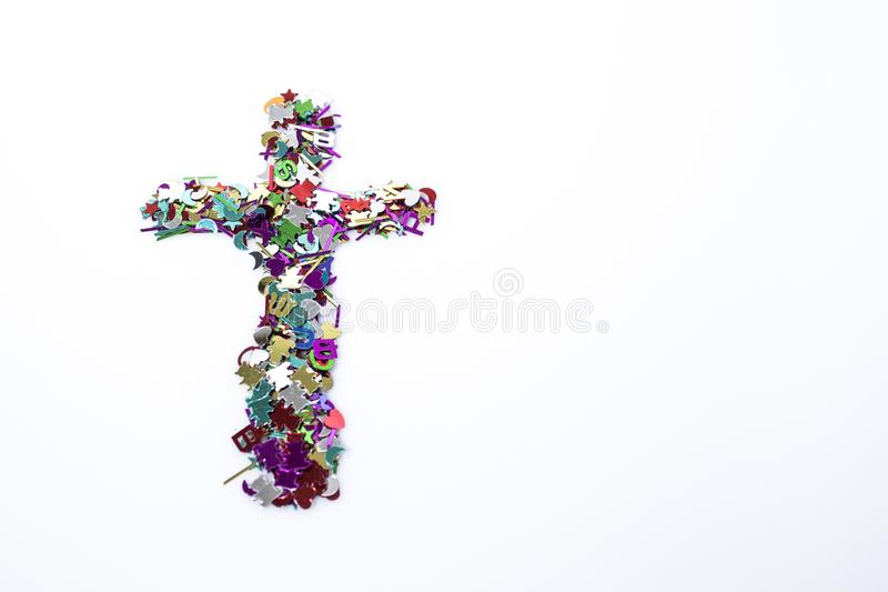 Abstract symbol crucifix multicolor in a white background. Composition stock images