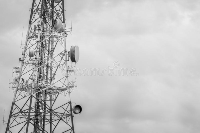 Abstract telecommunication tower Antenna and satellite dish with. Sunset sky background,Radio tower communication technology network stock photography