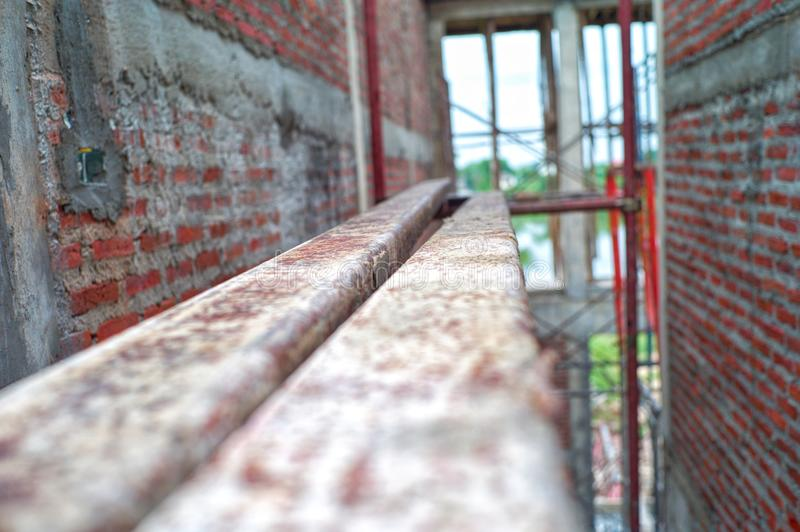 Abstract texture and background of steel bars put on the scaffolding for standing and working at high level. At the house under construction with bricklayer royalty free stock image