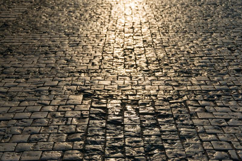 Abstract texture, background of sunlit road cobbles royalty free stock photos